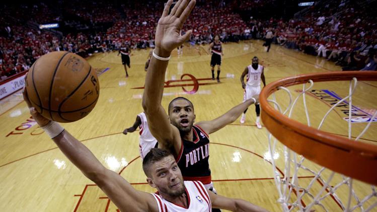 Houston Rockets' Chandler Parsons (25) goes up for a shot as Portland Trail Blazers' Nicolas Batum defends during the first half in Game 1 of an opening-round NBA basketball playoff series, Sunday, April 20, 2014, in Houston