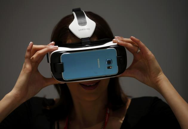 A woman uses a Samsung's new virtual reality (VR) headset called the Gear VR Innovation Edition during the Mobile World Congress in Barcelona