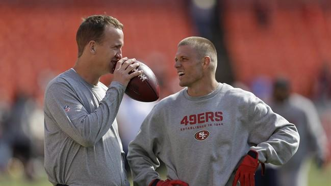 Denver Broncos quarterback Peyton Manning, left, talks with San Francisco 49ers wide receiver Austin Collie, right, before an NFL preseason football game on Thursday, Aug. 8, 2013 in San Francisco. B.C Lions Canadian receiver Collie is preparing for his first CFL season after four years in the National Football League. THE CANADIAN PRESS/AP/Ben Margot