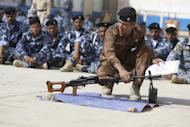 Newly-recruited Iraqi volunteers attend a training session at the Ibrahimiya police camp outside Karbala on June 19, 2014