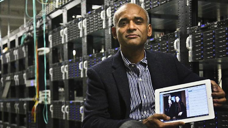 FILE - In this Thursday, Dec. 20, 2012, file photo, Chet Kanojia, founder and CEO of Aereo, Inc., shows a tablet displaying his company's technology, in New York. Aereo is one of several startups created to deliver traditional media over the Internet without licensing agreements. (AP Photo/Bebeto Matthews, File)