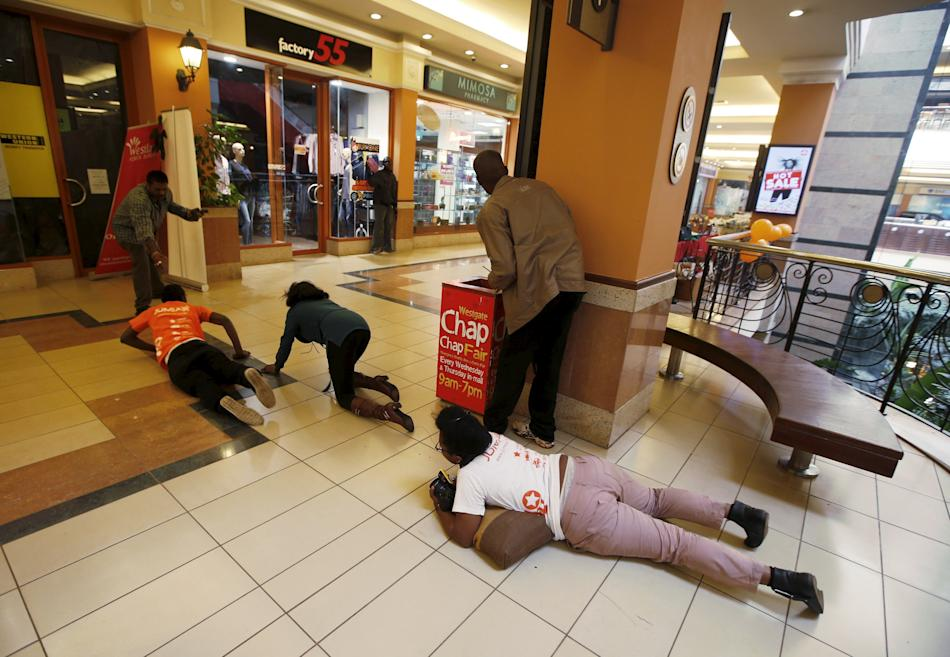 File photo of women crawling to safety as armed policemen search for gunmen during an attack at Westgate shopping centre in Nairobi