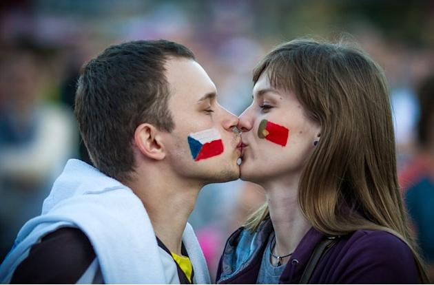 Supporters Of Czech Republic And Portugal Kiss AFP/Getty Images