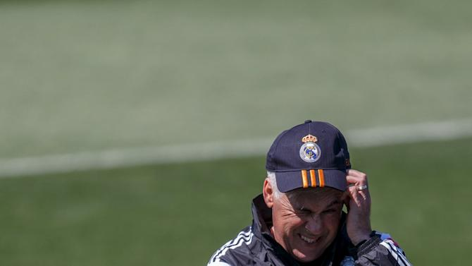 Real Madrid coach Carlo Ancelotti reacts during a training session at Valdebebas, outside Madrid, Spain