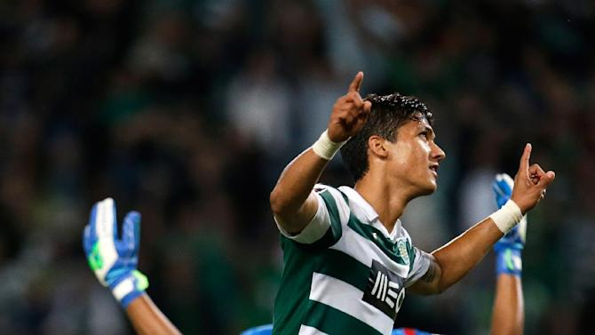 Sporting's Montero, from Colombia,  celebrates after scoring the opening goal against Setubal  during their Portuguese league soccer match Saturday, Oct. 5 2013, at Sporting's Alvalade stadium in Lisbon