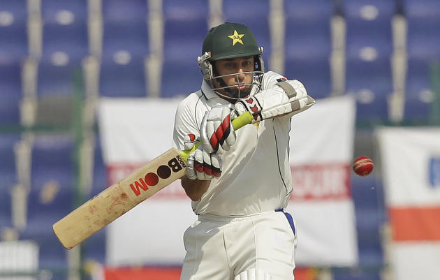 Pakistan's Saeed Ajmal hits the ball during the fourth day of the second cricket test match of a three match series between England and Pakistan at  Zayed Cricket Stadium in Abu Dhabi, United Arab Emi