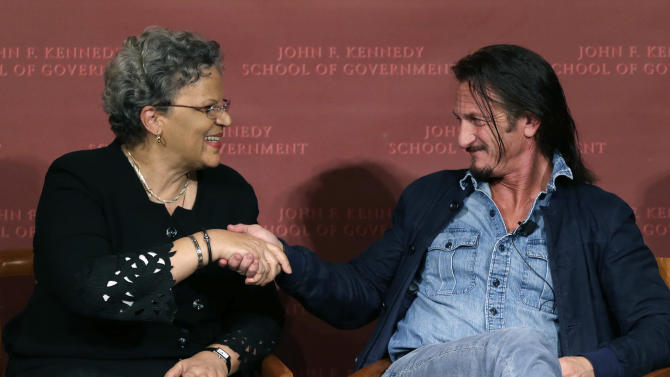 Actor-director Sean Penn shakes hands with the former prime minister of Haiti, Michele Pierre-Louis, after they participated in a discussion at Harvard University's John F. Kennedy School of Government in Cambridge, Mass. Tuesday, Feb. 26, 2013 regarding Haiti in the wake of a devastating earthquake three years ago. Penn is the co-founder of the J/P Haitian Relief Organization. (AP Photo/Elise Amendola)