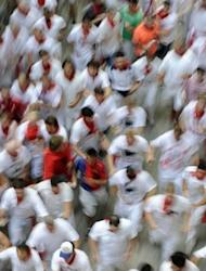 Participants run during the fourth bull run of the San Fermin Festival in the northern Spanish city of Pamplona. The six bulls from the El Pilar ranch, known for their speed, took just two minutes and 22 seconds to cover the 850-metre (2,800-foot) course, the fastest time of the four daily bull runs held so far this year