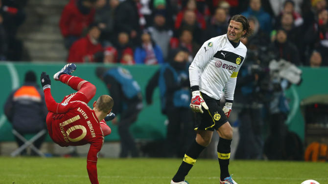 Daniel van Buyten of Bayern Munich challenges Robert Lewandowski of Borussia Dortmund during their German soccer cup, DFB Pokal, quarter final match in Munich