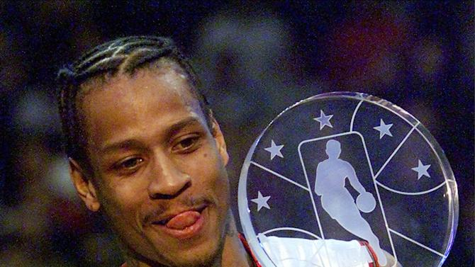 FILE - In this Feb. 11, 2001, file photo, Eastern Conference player Allen Iverson, of the Phildadelphia 76ers, holds his MVP trophy at the end of the 50th NBA All-Star Game at the MCI Center,  in Washington.  This year's Hall of Fame class includes a star-studded field of potential finalists, including Shaquille O'Neal, Yao Ming and Allen Iverson. That trio should be a lock to get in. (AP Photo/Pablo Matinez Monsivais, File)