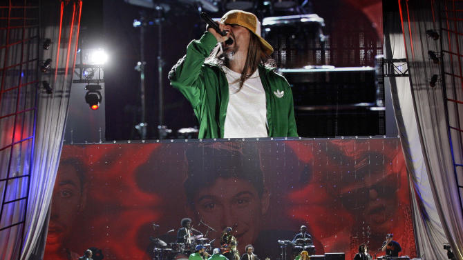 "Kid Rock performs with ""Roots"" after the Beastie Boys were inducted into the Rock and Roll Hall of Fame Saturday, April 14, 2012, in Cleveland. (AP Photo/Tony Dejak)"