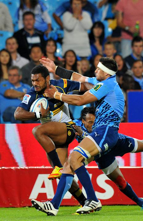 Australian ACT Brumbies' winger Henry Speight (L) runs to score a try during the Super 15 Rugby Match between Northern Bulls and Canterbury Crusaders at Loftus Versfeld stadium in Pretoria, on April 2