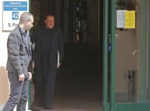IFormer Italian PM Berlusconi walks as he leaves the Sacred Family Foundation in Cesano Boscone