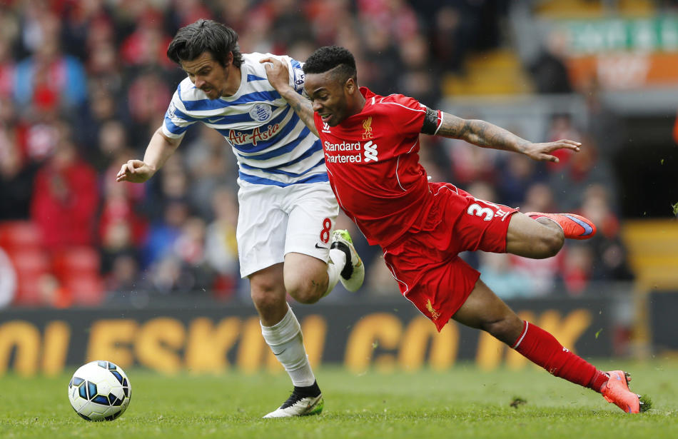 Football: Liverpool's Raheem Sterling and QPR's Joey Barton in action