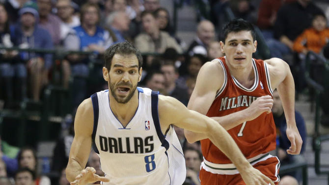 Dallas Mavericks point guard Jose Calderon (8), of Spain, drives up court as Milwaukee Bucks forward Ersan Ilyasova (7), of Turkey, give chase during the second half of an NBA basketball game Saturday, Dec. 14, 2013, in Dallas. The Mavericks won 106-93