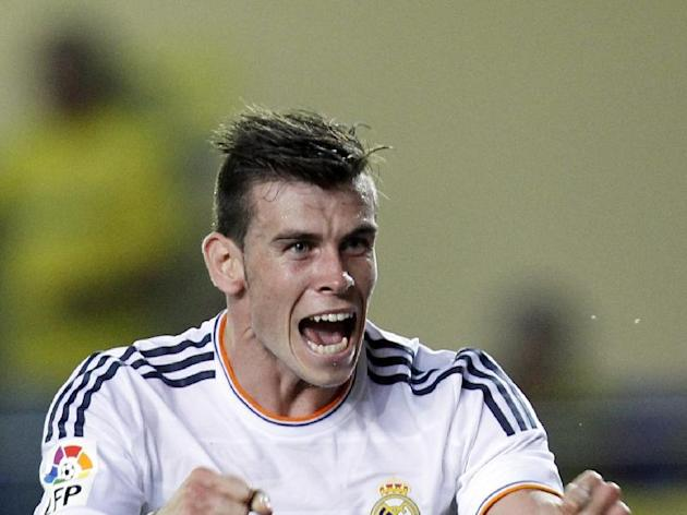 Real Madrid's Gareth Bale from Wales celebrates after scoring against Villarreal during their La Liga soccer match at the Madrigal stadium in Villarreal, Spain, Saturday, Sept. 14, 2013. (AP Photo/Alberto Saiz)