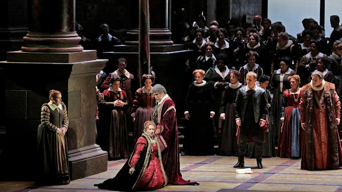 "In this March 11, 2013 photo provided by the Metropolitan Opera, Krassimira Stoyanova kneels in the role of Desdemona opposite Jose Cura in the title role during a performance of of Verdi's ""Otello,"" at the Metropolitan Opera in New York. (AP Photo/Ken Howard)"