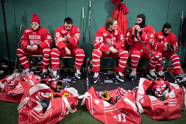 BOSTON, MA - JANUARY 08: Boston University Terriers Tommy Kelly #22, Gabriel Chabot #10, Jakob Forsbacka Karlsson #23, Bobo Carpenter #14 and Patrick Harper #21 prepare before taking the ice against the University of Massachusetts Minuteman at Fenway Park on January 8, 2017 in Boston, Massachusetts. (Photo by Michael Ivins/Boston Red Sox/Getty Images)