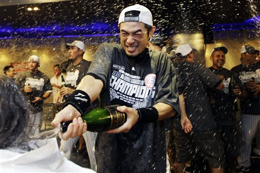 Ichiro Suzuki soaks up the winning feelings all over New York. (AP)