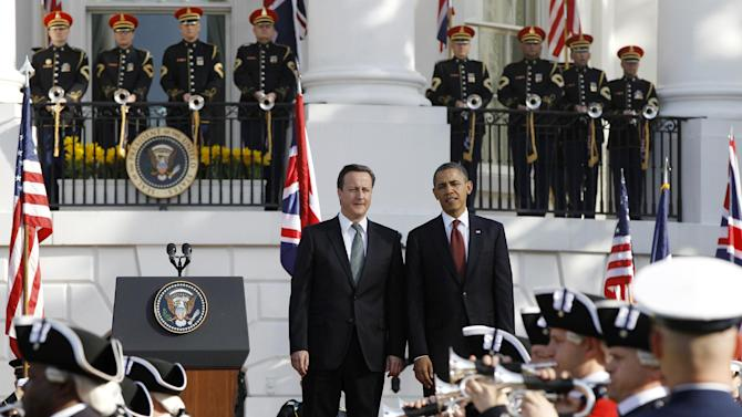 President Barack Obama welcomes British Prime Minister David Cameron during an official arrival ceremony on the South Lawn of the White House in Washington, Wednesday, March 14, 2012. (AP Photo/Charles Dharapak)