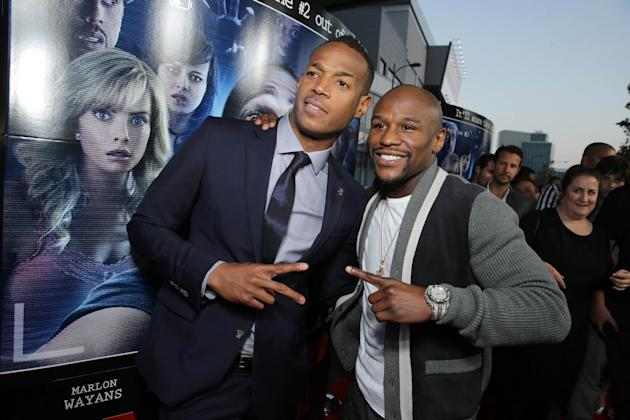 Writer/Producer Marlon Wayans and Floyd Mayweather Jr. seen at the Los Angeles World Premiere of Open Road Films 'A Haunted House 2,' on Wednesday, April 16, 2014 in Los Angeles. (Photo by Eri