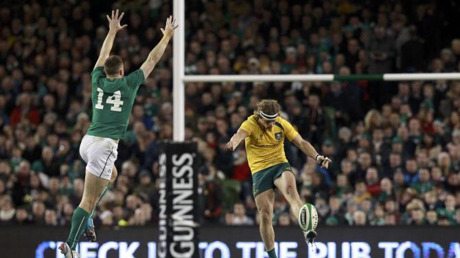 Ireland's Bowe challenges Australia Cummins in their International rugby union match in Dublin