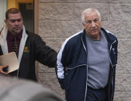Former Penn State assistant football coach Jerry Sandusky, right, leaves the office of Centre County District Justice Daniel A. Hoffman under escort by Pennsylvania State Police and Attorney General's Office officials in Bellefonte, Pa., on Thursday, Dec. 7, 2011. Sandusky was arrested and jailed Wednesday on new child sex abuse charges brought by two new accusers, including one who claims Sandusky molested him numerous times in a basement bedroom, according to authorities. (AP Photo/The Patriot-News, Andy Colwell)