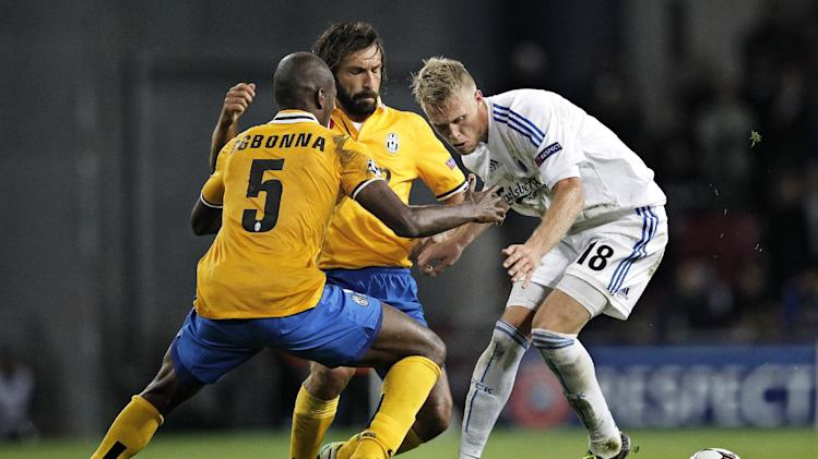 Juventus' Angelo Ogbonna, left, Andrea Pirlo, center, and FC Copenhagen's Nicolai Jorgensen, vie for the ball,  during their Champions League Group B soccer match against FC Copenhagen at Parken Stadium, Copenhagen, Denmark, Tuesday Sept. 17, 2013