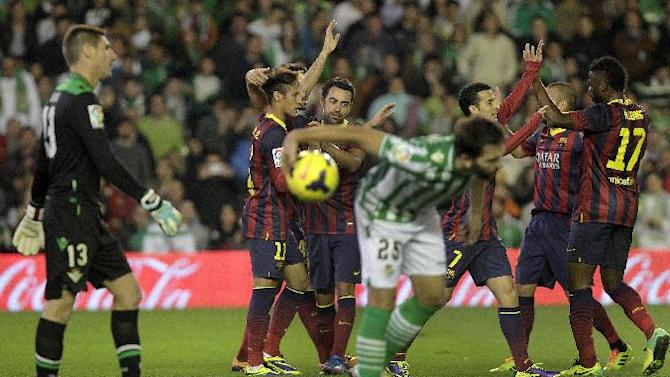 Barcelona's Neymar from Brazil, second left, celebrates with teammates after scoring against Betis during their La Liga soccer match at the Benito Villamarin stadium, in Seville, Spain, Sunday, Nov. 10, 2013