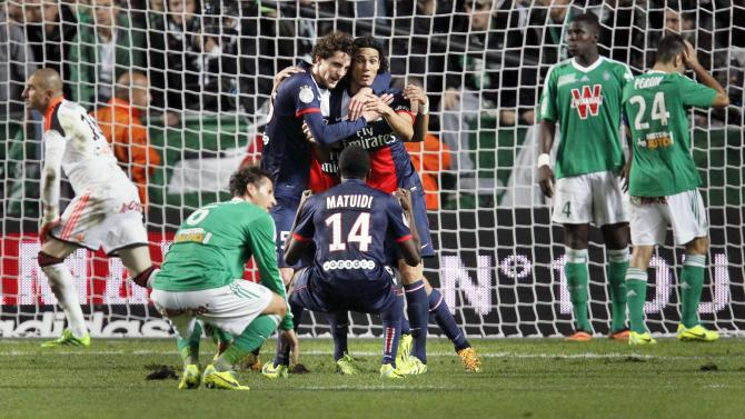 Matuidi of Paris St-Germain celebrates with teammates after scoring the equalizer against St Etienne during their French Ligue 1 soccer match in Saint-Etienne