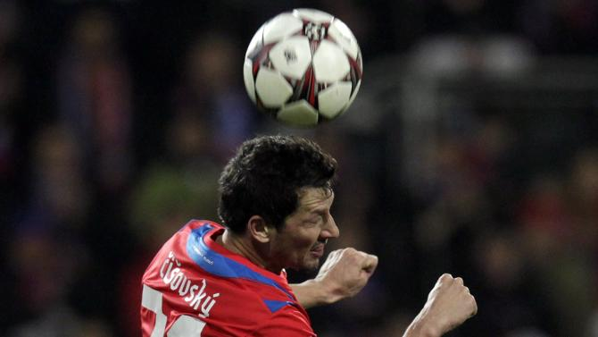 CSKA Moscow's Ahmed Musa and Viktoria Plzen's Marian Cisovsky jump for the ball during their Champions League soccer match in Plzen