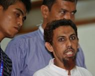 Umar Patek, the bombmaker accused of masterminding the 2002 Bali attacks that killed 202 people, speak to the press at the West Jakarta court in Indonesia on May 21. His insisted Monday that he only played a minor role and should be jailed for less than 15 years