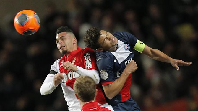 Monaco's Emmanuel Riviere of France challenges for the ball with Paris Saint Germain's  Thiago Silva of Brazil during their French League One soccer match, in Monaco stadium, Sunday, Feb. 9 , 2014