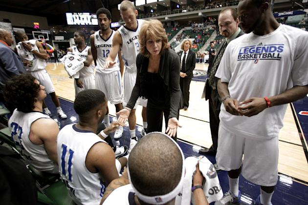 FILE - In this March 30, 2011 file photo, Texas Legends head coach Nancy Lieberman, center, leads her team during a time out in an NBA Development League basketball game against the Springfield Armor