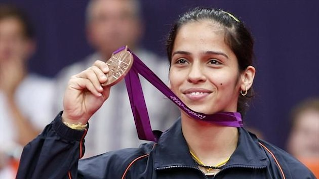 India's Saina Nehwal holds up her bronze medal at the women's singles badminton victory ceremony at the London 2012 Olympic Games at the Wembley Arena August 4, 2012 (Reuters)