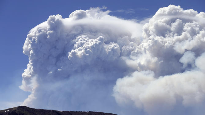 Wildfire smoke plumes above Del Norte Peak on Sunday, June 23, 2013, in near Del Norte, Colo. A wildfire near a popular summer retreat in southern Colorado continues to be driven by winds and fueled by dead trees in a drought-stricken area, authorities said Sunday. (AP Photo/Gregory Bull)