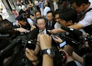 "North Korean Vice Foreign Minister Kim Kye-Gwan talks to the press as leaves his hotel in New York. The United States on Thursday pressed North Korea to take ""concrete and irreversible"" steps to give up its nuclear arsenal at talks on how to improve hostile relations"