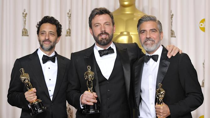 """Grant Heslov, from left, Ben Affleck, and George Clooney pose with their award for best picture for """"Argo"""" during the Oscars at the Dolby Theatre on Sunday Feb. 24, 2013, in Los Angeles. (Photo by John Shearer/Invision/AP)"""