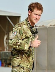 Prince Harry gives a thumbs up after walking by the Apache flight-line at Camp Bastion in Afghanistan.