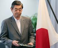 Japanese Foreign Ministry spokesman Yutaka Yokoi arrives for a press conference in Tokyo. South Korea has postponed at the last minute the signing of a landmark military agreement with Japan, amid anger in Seoul over the planned pact with a former colonial ruler