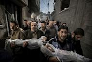 This handout photo taken by Swedish photographer Paul Hansen and released by the World Press Photo shows the bodies of two year-old Suhaib Hijazi and her three-year-old brother Muhammad -- who were killed in an Israeli missile strike -- being carried through Gaza City, on November 20, 2012