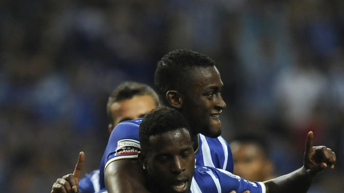 FC Porto's Silvestre Varela, front, celebrates scoring the opening goal against Gil Vicente with Jackson Martinez, from Colombia, in a Portuguese League soccer match at the Dragao stadium in Porto, Portugal, Sunday, Sept. 14, 2013