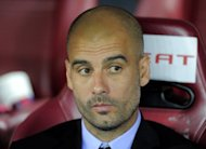Former Barcelona coach Pep Guardiola (pictured in May) on Friday insisted that he is happy living the family life in New York for now as he kept the guessing game about his future in football wide open
