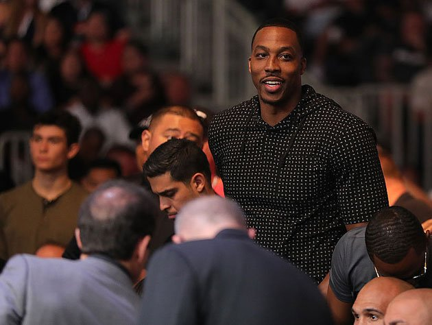 Dwight Howard takes in the fights. (Getty Images)