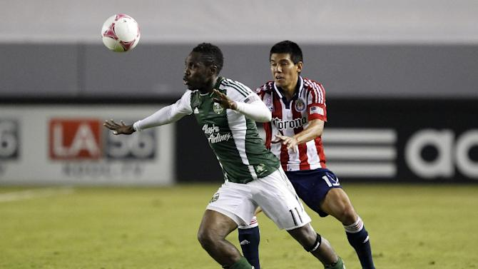 Portland Timbers midfielder Kalif Alhassan (11) battles for the ball with Chivas USA midfielder Josue Soto, right,  defending during the second half of an MLS soccer match, Saturday, Oct. 26, 2013, in Carson, Calif. Timbers won the match 5-0