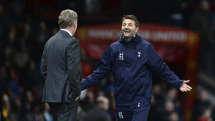 Tottenham Hotspur manager Sherwood celebrates at the final whistle as Manchester United manager Moyes looks on after their English Premier League soccer match in Manchester