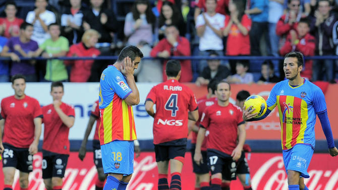 Levante's Sergio Ballesteros, left, reacts after Osasuna scored against his team during their Spanish La Liga soccer match, at Reyno de Navarra stadium in Pamplona, northern Spain, Sunday Oct. 30, 2011. (AP Photo/Alvaro Barrientos)