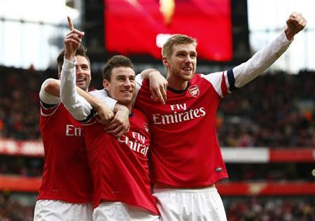 Arsenal's Koscielny celebrates his goal against Sunderland with Giroud and Mertesacker during their English Premier League soccer match at the Emirates Stadium in London