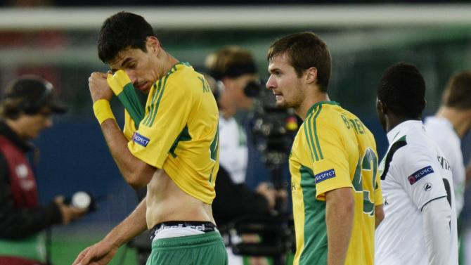 Kuban Krasnodar's Xandao, left, and Roman Bugaev, right, leave the pitch after the UEFA Europa League Group A f soccer  match between Switzerland's FC St. Gallen and Russia's Kuban Krasnodar at the AFG Arena in St. Gallen, Switzerland, Thursday, Sept.  19, 2013. St. Gallen won by  2-0