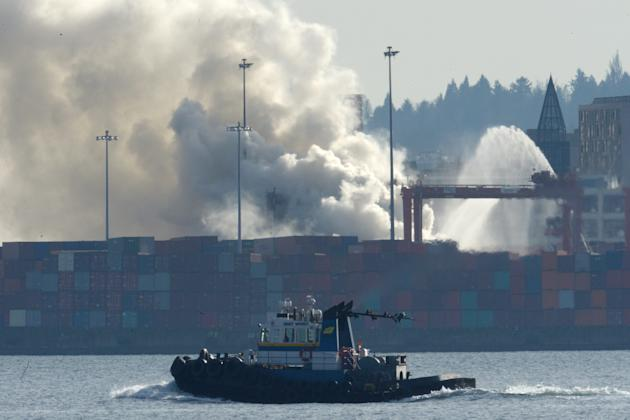 Smoke rises from a fire at the Port Metro Vancouver in Vancouver, British Columbia, Canada, Wednesday, March 4, 2015. Vancouver health officials are warning people near the city's port to stay ind